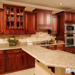 Walnut Merlot - Walnut Merlot cabinets, is a premium cabinetry collection that showcases the luscious tone of scarlet that perfectly blends with the rich natural wood feel. This falls among the darker stained kitchen cabinet options that RTA Cabinet Supply offers. So if you want a dramatic touch to your décor, then you need not look further...