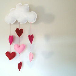 Valentine Cloud Mobile by Ostenfeld - This felt cloud mobile dripping with stuffed hearts is so sweet that it could make the rain, rain go away. I would use this in a nursery, of course, but I could also hang it in my closet for a reminder to love every day.