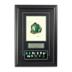 """Heritage Sports Art - Original art of the NHL 1990-91 Dallas Stars jersey - This beautifully framed piece features an original piece of watercolor artwork glass-framed in an attractive two inch wide black resin frame with a double mat. The outer dimensions of the framed piece are approximately 17"""" wide x 24.5"""" high, although the exact size will vary according to the size of the original piece of art. At the core of the framed piece is the actual piece of original artwork as painted by the artist on textured 100% rag, water-marked watercolor paper. In many cases the original artwork has handwritten notes in pencil from the artist. Simply put, this is beautiful, one-of-a-kind artwork. The outer mat is a rich textured black acid-free mat with a decorative inset white v-groove, while the inner mat is a complimentary colored acid-free mat reflecting one of the team's primary colors. The image of this framed piece shows the mat color that we use (Hunter Green). Beneath the artwork is a silver plate with black text describing the original artwork. The text for this piece will read: This original, one-of-a-kind watercolor painting of the 1990-91 Minnesota North Stars (now Dallas Stars) jersey is the original artwork that was used in the creation of this Dallas Stars uniform evolution print and tens of thousands of other Dallas Stars products that have been sold across North America. This original piece of art was painted by artist Nola McConnan for Maple Leaf Productions Ltd. Beneath the silver plate is a 3"""" x 9"""" reproduction of a well known, best-selling print that celebrates the history of the team. The print beautifully illustrates the chronological evolution of the team's uniform and shows you how the original art was used in the creation of this print. If you look closely, you will see that the print features the actual artwork being offered for sale. The piece is framed with an extremely high quality framing glass. We have used this glass style for many years with exc"""