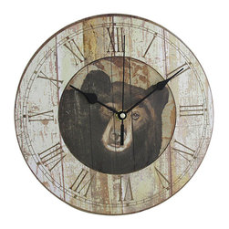9 1/2 Inch Diameter Black Bear Kitchen Wall Clock Wildlife - Made of fiberboard, this gorgeous 9 1/2 inch diameter battery powered wall clock features a weathered plank-board print, with the face of a black bear in the center. It has roman numeral markers and black hands. The clock has a distressed look, with wear marks and printed scratches as part of the design. It runs on one AA battery (not included). This wall clock makes a great gift for bear lovers, or anyone who loves wildlife.