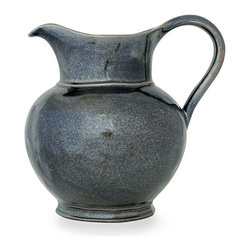 Pewter Stoneware Large Pitcher - Invoke tradition on your dining table with the underlying glow of authentic pewter, perfectly mimicked by the glaze of the Pewter Stoneware Large Pitcher. Durable and practical, yet distinctive and elite, this remarkable vessel suits every meal and complements the tones of heirloom silver and everyday flatware alike; its round belly segues smoothly into a pulled spout.