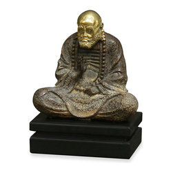 China Furniture and Arts - Hand Forged Bronze Meditating Monk - Bodhidarma (commonly called Damo in Chinese or Daruma in Japanese) was the Buddhist monk traditionally credited as the transmitter of Chan to China. In early 5th century CE, at the age of 64, he journeyed from India to China to broaden his vision on Buddhism and subsequently relocated northwards. After years of meditation at the Shaolin Temple, Da Mo founded the philosophy of Chinese Zen Buddhism. In Chinese culture, he represents wisdom, compassion, strong-will, determination, meditation, mind development, and the unity of spirit and body. Completely hand forged in bronze, this statue is a masterpiece of art. Matching wooden stand included.