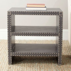 Safavieh Lacey Side Table - The Safavieh Lacey Side Table comes complete with not just a gorgeous style, but convenient storage as well. The sturdy metal design features two open shelves for display and organization. The faux-leather look and nail head detail provide striking accents that really set this table apart. Available in Charcoal, Grey, Light Green, or White Croc finishesAbout SafaviehConsidered the authority on fine quality, craftsmanship, and style since their inception in 1914, Safavieh is most successful in the home furnishings industry thanks to their talent for combining high tech with high touch. For four generations, the family behind the Safavieh brand has dedicated its talents and resources to providing uncompromising quality. They hold the durability, beauty, and artistry of their handmade rugs, well-crafted furniture, and decorative accents in the highest regard. That's why they focus their efforts on developing the highest quality products to suit the broadest range of budgets. Their mission is perpetuate the interior furnishings craft and lead with innovation while preserving centuries-old traditions in categories from antique reproductions to fashion-forward contemporary trends.