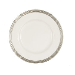Tuscan Salad/Dessert Plate - Several concentric lines of glamorously simple etching accent the metal outlines of this ceramic and pewter salad plate. The center portion is pure white, the outer rim handcrafted by master metalworkers in Italy from genuine pewter. Ideal for the formal meal or for the more casual dessert among friends, this small, classy dish has European sleekness and transitional chic, but its traditional materials are at home in the most elegant decor.