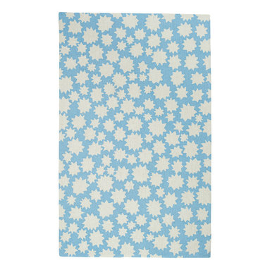 Stars rug in Spa Blue - We took inspirations for this collection by just staring at the sky.  The stars, rainbows, and clouds are infinite reminders to celebrate the natural beauty all around us.  This collection works in many spaces - a child's room, an office, a living room, anywhere.