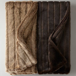 Faux Fur Throw - A faux fur throw is oh-so-cozy and very versatile. It's perfect to bring out for the winter months.