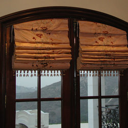 Roman Shades - Elegant silk embroidery soft fold roman shades with arched top to mimic shape of the french doors. Installed on doors to open and close with them.