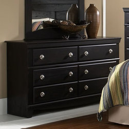 Standard Furniture - 6-Drawer Dresser in Dark Pecan - Carlsbad - Refined lineage and interesting detail throughout reveal a dynamic straight forward design. Round ornaments in a simulated brushed nickel color finish on the headboard. French dovetail construction throughout enhances durability. Beautiful Dark Pecan finish with a rubbed-though appearance. Roller side drawer guides provide ease and convenience. Top drawers are felt lined to protect delicate items. Quality wood products bonded together create durable construction throughout. Cast metal knobs with a round back plate in simulated brushed nickel color finish. 16 in. W x 58 in. L x 32 in. H (127 lbs.)Carlsbad features a modern style through a blend of clean lines and simple adornments.