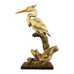 Driftwood Look White Heron Statue Egret Bird - This big, beautiful cold cast resin white Egret statue is finished to look like it was carved from driftwood. The statue measures 18 1/4 inches tall, 9 1/2 inches wide and 4 3/4 inches deep. It will look great in any room with a nautical or nature theme.