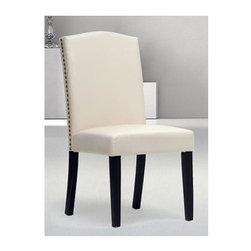 Baxton Studio - 25 in. Modern Dining Chair - Set of 2 - Set of 2. Polyurethane foam cushioning. Faux leather upholstery. Wooden frame with black lacquer legs and non-marking feet. Antiqued brass nail head trim along chair's sides. Wipe with damp cloth. Beige color. Assembly required. Seat: 19.12 in. W x 18.37 in. D x 19.12 in. H. Overall: 25 in. W x 19.12 in. D x 38.25 in. H (14 lbs.)