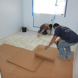 Residential remodel - Redondo Beach - Bedroom #1 - during (gluing down sound reducing cork underlay)
