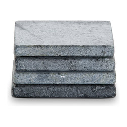Jewett Farms Co - Soapstone Coasters - Protect your surfaces in style. Our sleek soapstone coasters are naturally light gray in color but if oiled will become black with white venining that creates a pop of visual interest. Soapstone is non-porous and can't be stained, so if any red wine or coffee slips from your glass or cup it can be simply wiped away. Functional and fun, our soapstone coasters are sold in a set of 4. Handmade at our Dover NH soapstone fabrication shop using offcuts and remnants, reducing waste and increasing creativity.