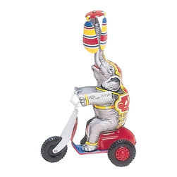 """Alexander Taron - German Collectible Tin Toy - Elephant on Scooter - 8.5""""H x 3.5""""W x 5.5""""D - Tin wind-up circus elephant rides on scooter while balancing turning propellers."""