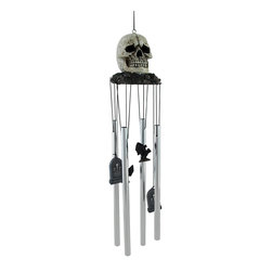 `The Bell Tolls` Gothic Skull Wind Chimes Windchimes - This awesome Gothic skull wind chime is the perfect gift to any skull lover of fan of the macabre. Made of cold cast resin and aluminum, the chimes feature a 4 inch diameter skull atop a leafy brown base. Gravestones and bats hang down to ring the chimes. The wind chimes measure 18 inches from the top of the skull to the bottom of the longest chime. They look great, indoors or outdoors.