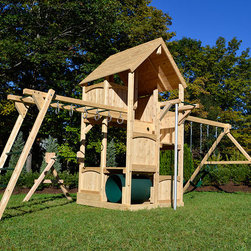 Canterbury Climber - White cedar swing set with monkey bars, fire pole, turning bar and a wood roof.