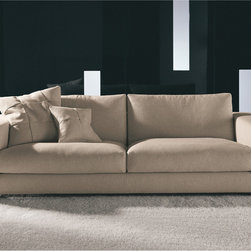 Minotti - Minotti Hamilton Sofa - The Hamilton Collection is synonymous with a successful blend of technological innovation and creative charms.  A really original seating system, with a firm, chameleon-like character capable of catering to any room and any need.  Three different sofa sizes are available.  The sofa frame is made of solid wood.  The frame is prepped with high resilience polyurethane foam of various densities and wrapped in a lining made from fiber thermally bound to a white cotton cloth.  Seat suspension is provided by woven elastic straps with a high rubber content and controlled elasticity.  Seat and back cushions are padded with goose down divided into sections and high resilience polyurethane inserts.  Two options are available for the sofa base a metal frame and a wood foot.  The metal frame is finished in glossy black-nickel.  The wooden feet are open pore ash finished with a mocha color.  Upholstery is available in fabric or leather.  Fabric covers are fully removable once the external supporting base is taken apart.  Several optional cushions are available for an additional charge.  Hamilton collection includes a sectional sofa, chaise lounge, ottoman and complimentary set of tables.  Price includes delivery to the USA.  Manufactured by Minotti.