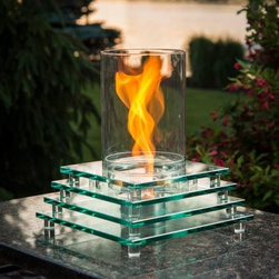 "Outdoor GreatRoom Harmony Tabletop Fire Pit - The Outdoor GreatRoom Harmony Tabletop Fire Pit is so much more than a warm welcoming flame although it's that too. The special Venturi flame technology uses a turbo disc in a tempered glass cylinder to create a beautiful spinning effect. Gel fuel similar to a sterno can burns an alcohol-based gel fuel that's safe for use indoors or out. And that's not all - the bora silicate chimney has an eye-catching glass and crystal base that makes any space elegant. Normal burn without Venturi effect is 1.5 hours up to three hours without. Burns up to 9 000 BTUs when spinning. UL-listed and safety tested. About Outdoor GreatRoom CompanyWith over 50 patents to its name the Outdoor GreatRoom Company is one of the most innovative names in gas fireplaces and outdoor design period. Since 1975 Dan Ron Steve and Ger have produced a yard of amazing products like the Heat-N-Glo that have changed the industry. In fact they want to change the way you think about your backyard or patio. It's about bringing the luxury and comfort of the living room outside to make an """"Outdoor Room."""" They want you to literally think outside the box. To make that beautiful concept a reality Outdoor GreatRoom designs manufactures and sells pergolas outdoor kitchens grills outdoor furniture fireplaces fire pits lighting and heating products. There's no better name in outdoor leisure than this fine Minnesotan company."