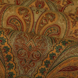 Eugenie Paisley Upholstery Fabric in Havana - Eugenie Paisley Upholstery Fabric in Havana has shades of tan, gold, green, and red sprawled in an intricate paisley pattern that creates an exotic look for interior designs. Made in Italy from 100% cotton. Width: 55″; Repeat: L:34″