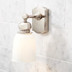 """Covington Hotel Sconce, Single, Polished Nickel finish - We designed our Covington Collection in the style of antique fittings found on early-20th-century trains. Our sconce is crafted of solid steel for exceptional strength, and fitted with a bell-shaped white glass shade. 5"""" wide x 6.5"""" deep x 10.5"""" high Cast of aluminum and galvanized steel thickly plated for strength. White glass shade. Ceramic socket. Hand-applied finish. Damp UL-listed. Hardwire; professional installation recommended. View our {{link path='pages/popups/fb-bath.html' class='popup' width='480' height='300'}}Furniture Brochure{{/link}}."""