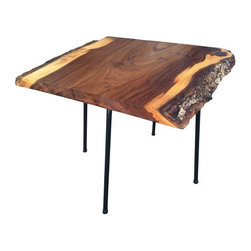 Pre-owned Mod George Nakashima Style Cocktail Table - 1950's & Fabulous!    Give your living room a woodsy feel with the help of this handsome coffee table. The piece was inspired by the designs of George Nakashima, a master woodworker known for creating furniture that emphasized the intricate grains, textures, and fissures that are naturally found in wood. To create the table, a slab of English Elm was kiln dried, sanded, and treated with tung oil to preserve its original appearance, then outfitted with vintage iron legs from the 1950's. Simple and sleek, this Marzipan Mummy piece will remind you to appreciate the beauty of the natural world.