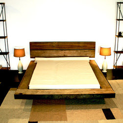 Mossam Platform Bed - This bed is super sleek and modern, but it doesn't feel cold. The warm woods still bring it back to nature. The headboard is separate from the platform frame, a touch that I really love. This masculine bed would be perfect for a bachelor pad.