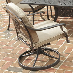 HomeStyles - 36 in. Swivel Chair - Includes woven sunbrella weather resistant antique gold fabric cushion. Extruded aluminum frame with nylon glides on all legs. Gold flecks is sealed with clear coat to protect the finish. Chocolate metallic powder coated color. Arm height: 24.5 in. H. Seat height: 16 in. H. Overall: 29.25 in. W x 25.5 in. D x 36 in. H. Warranty. Assembly InstructionsHome styles covington outdoor dining collection gives the beauty of ornately designed pieces without the high cost. Chairs are oversized for added comfort. You can choose to use the back cushions, or they can be removed to display the intricate decorative designed back.