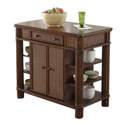 Home Styles - Home Styles Marco Kitchen Island Palm in Refined Cinnamon - Home Styles - Kitchen Carts - 519494 - Marco Kitchen Island is constructed of mahogany solids, albazia solids, and engineered woods with Natural woven wicker panels and leather wrapped accents in a Refined Cinnamon Finish. Features include a storage drawer, storage cabinet with two adjustable shelves, doors open from both sides provide excellent access, with unique push through drawer which opens from either side, and two fixed shelves on sides. Size: 41w 23.75d 36h. Palm Mahogany hardware.