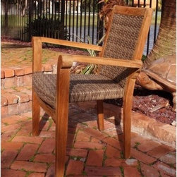 "Panama Jack Leeward Islands Stackable Arm Chair - Natural Teak with Viro Wicker - The Panama Jack Leeward Islands Stackable Arm Chair - Natural Teak with Viro Wicker is a wonderful addition to any outdoor furniture setting. Every item in the Leeward Islands collection incorporates a high-grade Indonesian teak frame with a natural finish. Incorporating a unique combination of outdoor materials, the Viro synthetic fiber comes in a beautiful dark finish. The comfortable armchair is stackable for easy transportation and storage. Plus, it is both weather- and UV-resistant for durable outdoor use. Teak will weather gracefully if untreated, so maintenance with teak oil and light sanding is suggested (oil not included). Dimensions: 25W x 25D x 35H inches.About Hospitality RattanHospitality Rattan has been a leading manufacturer and distributor of contract quality rattan, wicker, and bamboo furnishings since 2000. The company's product lines have become dominant in the Casual Rattan, Wicker, and Outdoor Markets because of their quality construction, variety, and attractive design. Designed for buyers who appreciate upscale furniture with a tropical feel, Hospitality Rattan offers a range of indoor and outdoor collections featuring all-aluminum frames woven with Viro or Rehau synthetic wicker fiber that will not fade or crack when subjected to the elements. Hospitality Rattan furniture is manufactured to hospitality specifications and quality standards, which exceed the standards for residential use.Hospitality Rattan's Environmental CommitmentHospitality Rattan is continually looking for ways to limit their impact on the environment and is always trying to use the most environmentally friendly manufacturing techniques and materials possible. The company manufactures the highest quality furniture following sound and responsible environmental policies, with minimal impact on natural resources. Hospitality Rattan is also committed to achieving environmental best practices throughout its activity whenever this is practical and takes responsibility for the development and implementation of environmental best practices throughout all operations. Hospitality Rattan maintains a policy of continuous environmental improvement and therefore is a continuing work in progress.Hospitality Rattan's Environmentally Friendly Manufacturing ProcessAll of Hospitality Rattan products are green. From its basic raw materials of rattan poles, peels, leather, bamboo, abaca, lampacanay, wood, leather strips, and boards, down to other materials like nails, staples, water-based adhesives, finishes, stains, glazes and packing materials, all have minimum impact to the environment and are safe, biodegradable, recycled, and mostly recyclable. Aside from this, the products have undergone an environmentally-friendly process that makes them """"greener."""" The company's rattan components are sourced from sustained-yield managed forests, which means the methods used to grow and harvest the rattan vines ensure the long-term life of the forest and protect the biodiversity of the forest's ecosystems.Hospitality Rattan is committed to buying and using all materials, from rattan and hardwood to finishing materials, from reputable and renewable suppliers and seeks appropriate evidence that suppliers are in compliance with this policy. Hospitality Rattan strives to use materials that are processed in an environmentally responsible manner, or consist of a high level of recycled material. Finishing materials and stains used in Hospitality Rattan's furniture products consist of 75% water-based solutions which evaporate upon application with reduced or Volatile Organic Compounds (VOCs). The furniture factories use water-based glues, stains, topcoats and other finishes on all of their products. The switch from traditional solvent-based processes to water-based processes involved consolidating several processes by the factories, resulting in an 85% reduction in VOC emissions."