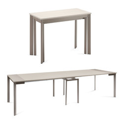 """DomItalia Furniture - Mondo Extendable Dining Table in Taupe / Sand - Make dining and entertaining possible in small and large spaces with Mondo Extendable Dining Table in Taupe / Sand. This modern console/dining table expands into a large dining table and allows large dinner parties in small living spaces. With a sturdy steel frame and leaf extensions, the table by Domitalia expands up to 136.5"""" long and seats 10 people comfortably. The Mondo collapses to 39"""" to free up floor space when not entertaining. It transitions to an accent piece to be used in a hallway, living room or kitchen lending to a range of modern aesthetics."""