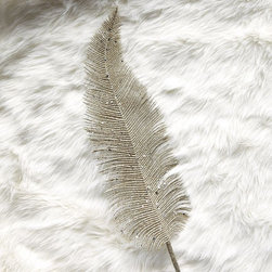 Glitter Feather - Feathers were a favorite accessory in the '20s. Try adding these glittery feathers to your holiday decorations.
