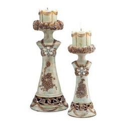 Vintage Rose Candleholder - Set of 2 - Add romance to any room with the Vintage Rose Candleholder - Set of 2. Carved of polyresin, these two candleholders have a floral design accented by faux pearls and faux diamonds nestled among gold, silver, and soft stone green accents. Includes two highly decorative pillar candles.About Ore International, Inc.Ore International, Inc. creates beautiful accent furniture, lighting, and gifts for the home. Their goal is to be the leading provider of innovative, superior home products worldwide. Ore International is based in Santa Fe Springs, California and has a Customer First attitude. Their products are designed to match modern and classic tastes and fit today's homes. From room dividers to lamps, end tables to entertainment centers, you'll discover quality craftsmanship at a fair price in all Ore International products.