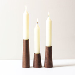 Slender Walnut Taper Holders - Set of 3 - Simplicity is a beautiful thing on these hand-carved walnut taper holders. They narrow from the base, so they nearly seem to flow seamlessly into your candles. Enjoy a candlelit dinner with a place setting that looks equally warm in the daytime.