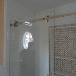 """Direct Roll Sliding Tub Enclosure - Direct roll sliding tub enclosure, fully frameless.  Hardware is brushed stainless, 3/8"""" starphire low iron glass."""