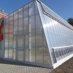 School Greenhouse Projects - This greenhouse was manufactured for PS 216 in Brooklyn, NY as part of The Edible Schoolyard project. Designed by WorkAC, this greenhouse capitalizes on solar gain with a unique reverse slope.