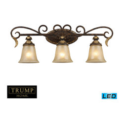 Elk Lighting - Regency LED 3-Light Vanity Bar in Burnt Bronze - Inspired by the scrolling design of the trump family crest, regency creates a rich and regal ambiance. The solid cast iron scrolls and burnt bronze finish compliments the delicate weathered gold leaf accents and caramel amber glass to create a dramatic and stunning collection. - LED, 800 lumens (2400 lumens total) with full scale dimming range, 60 watt (180 watt total)equivalent, 120V replaceable LED bulb included.