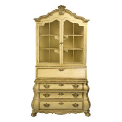 Painted Dorothy Draper Bookshelf Secretary - This impressive cabinet was designed by Dorothy Draper for Henredon. It features a Dutch-style bombe base with three drawers, splayed feet, and intricately chased brass drop pulls. Above the base is a drop-front secretaire unit, with two drawers, a closed compartment, and open pigeonholes for sorting. Atop the secretary is an open section with three bookshelves, accessed via two arched top doors having brass wire mesh inserts. Surmounting the bonnet top is a plume-form finial, accentuating Draper's signature flowing ornamentation. This lovely piece is finished in the original subtle pale yellow lacquer, with gold overglazing highlighting details of particular interest.