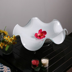 None - White Glass Fruit Bowl with Silver Stand - Fill it with ripe,luscious fruit or let it stand on its own silver feet. This glass fruit bowl is made with dramatic,curving edges,so it doubles as a decor accent. The bowl's white glass top and silver stand combine for a sleek,contemporary aesthetic.