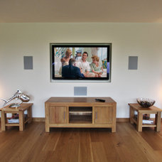 Traditional Family Room by Olive Audio Visual