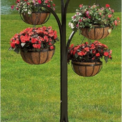 Woodstream - Black Round Coco Liner/Mild Steel 4-Arm Tree with Hanging Baskets - HB4T-A - Shop for Plant Hooks Shelves and Stands from Hayneedle.com! Display plants and flowers anywhere in your yard with the 4-Arm Tree with Hanging Baskets. The tree stand is made of strong tubular steel and stands over 5.5 feet tall. Included are four 12-inch matching hanging wire baskets with 3-part chains. Each basket has a natural coco liner that molds to the interior of the baskets and evenly distributes soil so proper nutrients and moisture reaches roots. The 4-Arm Tree with Hanging Baskets is perfect for plant enthusiasts who want to display planters but have no posts or rails available. Add blooms and greenery to your pool area or place the 4-Arm Tree in the center or your flower garden for multiple levels of plants. A little imagination goes a long way when decorating with this lovely tree. About Woodstream and CobraCoA privately held company with a long-standing positive reputation Woodstream is a global manufacturer and marketer of quality products from pets and wildlife control and home and garden products to bird feeders and garden decor. They have a 150-year history of excellence growth and innovation and have built a strong presence in key markets through organic growth and strategic acquisitions. Most recently Woodstream acquired CobraCo which offers an extensive line of planters baskets flower boxes and accessories. The growth of Woodstream is thanks to their customer-driven approach to product development a dedicated design organization that focuses on innovation quality and safety as well as a commitment to an industry-leading level of service.