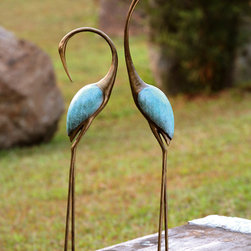 Stylized Crane Garden Statues (Pair) - As beautifully depicted as might be found on an Oriental painted screen, this set of two aluminum garden cranes will bring a Zen sense of calm and statuesque presence to an outdoor setting. One looks forward, the other back.