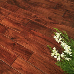 Acacia Hardwood Flooring - With a beautifully blended assortment of colors, Acacia is a tasteful choice that exudes an unmistakable air of sophistication, all the while sporting a surprisingly reasonable price tag. Its medium to dark brown heartwood is tinged with vibrant reddish orange and accented with light yellows.