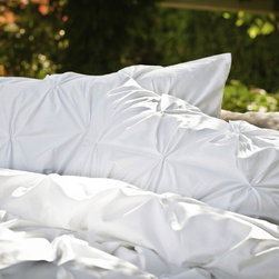 Crane & Canopy - White Valencia Pintuck Sham - King - Combining soft tones with modern textures, the Valencia pintuck duvet cover set gives a look that is full of volume and elegance. The Valencia in pearl white will subtly bring your room to life.