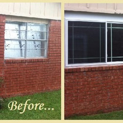 Champion Replacement Windows - Take a look at this before-and-after shot of a house with new, energy efficient Champion vinyl replacement windows.