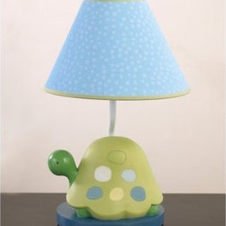 CoCaLo Turtle Reef Lamp Base & Shade - Your little one will love the happy frog on the CoCaLo Turtle Reef Lamp Base and Shade. This adorable turtle lamp is a perfect match to the Turtle Reef Bedroom Collection. It features a resin base with the carved dark green turtle with a light green shell sitting on a blue disk. The turtle has colorful spots and sits beneath the light blue and white conical shade that has green trim. This light requires a 40-watt bulb which is not included. Happy little turtle.About CoCaLoToday's parents look to CoCaLo for distinctive home decor items to welcome a new baby home. Founded in 1998 by Renee Pepys Lowe and named for her inspiration - daughters Courtenay and Catherine Lowe - CoCaLo designs complete nursery collections with a full assortment of coordinating accessories to provide parents the resources to create a beautiful cozy and safe nursery. Quality consistency and fashionable products are hallmarks of the CoCaLo commitment to excellence and a guarantee to its customers whether you are a first-time parent a grandparent or a family member or friend purchasing a thoughtful baby shower gift.