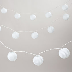 World Market - Round Paper 10 Bulb String Lights - Nothing says ''party'' like string lights. Our Round Paper 10 Bulb String Lights are suitable for indoor and outdoor decorating. End-to-end plug allows three strands to be connected together. Due to straight-line construction, if one bulb burns out the rest will remain lit. UL approved. 9-foot long strand.