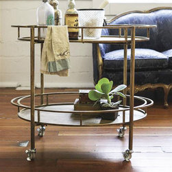 Gold and Metal Bar Cart - Gold and metal pair to create a stylish bar cart, perfect for welcoming guests. It has two tiers so you can wheel out your drinks during your soir�_�e. All you need is an aperitif or two, and you'll be set.