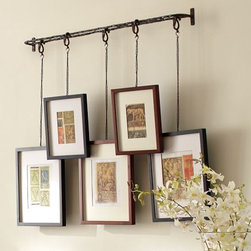 Twig Display System - Having photos of my work displayed in my office is so important, considering how visual my field is. I love how unique this Pottery Barn framing system is.