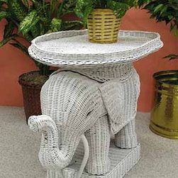 Wicker Elephant Table - This funky little table adds big personality to any space in your home, and no, you don't have to be a Republican to enjoy perching your martini atop a wicker elephant.