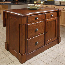 HomeStyles - Kitchen Island in Cherry Finish - Four drawers. Storage cabinet with one adjustable shelf. Recessed door panels. Profiled edge top. Bold molding detail. Unique hidden sliding mechanism connected to back two posts. Provides easy mobility and independent movement. Extended breakfast bar. Made from mahogany woods and veneers. Rustic cherry finish. Made in Indonesia. Without drop-leaf: 48 in. W x 26.75 in. D x 36 in. H. With drop-leaf: 48 in. W x 39 in. D x 36 in. H. Assembly InstructionsCreate ambiance with a perfect balance of warmth and style with the Aspen Collection. This piece has a polished look by being consistently styled on both the approach and working sides.