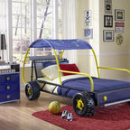Kids Dune Buggy Car Twin Bed - Get your child ready to drive off into dreamland on the Dune Buggy Car Twin Bed. This fun twin size bed is the perfect centerpiece to your race car loving child's bedroom. The metal shaped bed is reminiscent of a dune buggy and features realistic wheels, headlights and bumpers. A star and moon canopy hangs over a portion of the car. The blue, silver, black and red finish is the perfect color scheme for a little boy's room. Fits a standard twin size mattress, sold separately. Some Assembly Required.